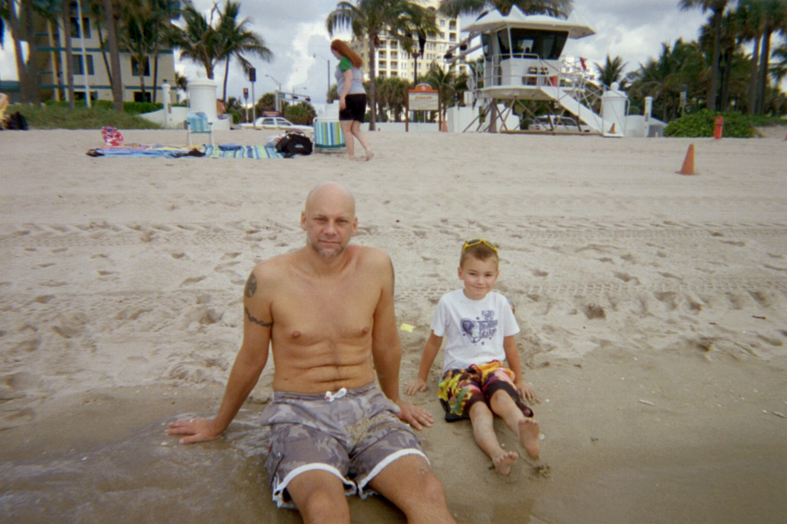Son, David, and grandson, Paul, relaxing on the beach